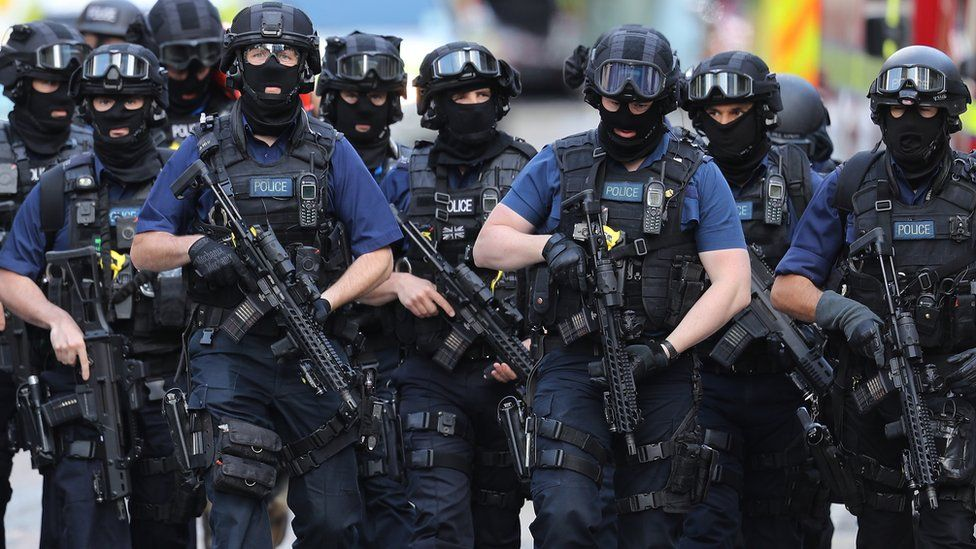 Counter terrorism officers march near the scene of the London Bridge terrorist attack, 5 June 2017