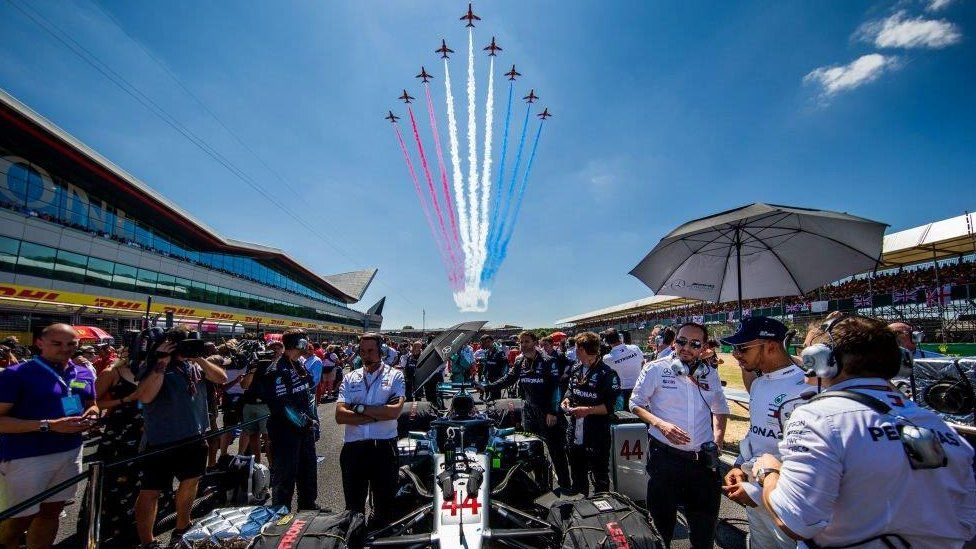 Mercedes driver Lewis Hamilton and the Red Arrows display team at the 2018 Silverstone Grand Prix.