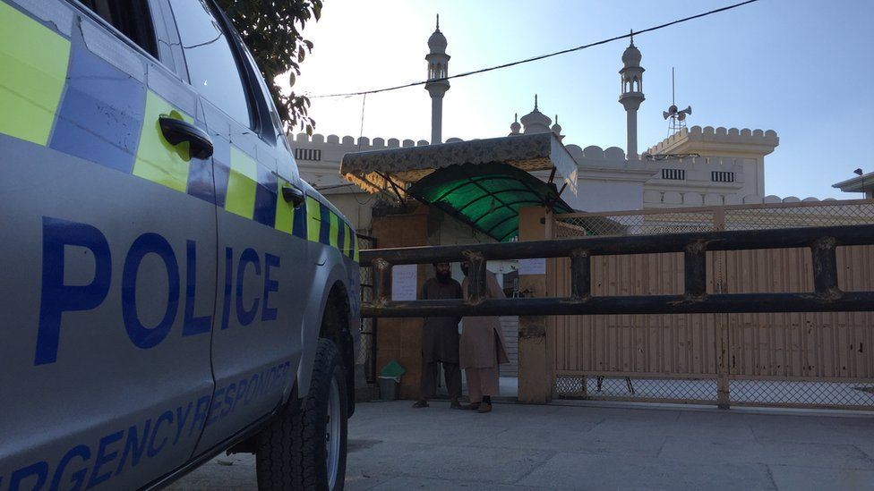 A police car parked in front of a former JuD-run mosque in Islamabad