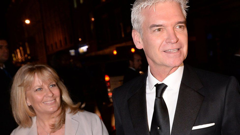 Philip Schofield and wife Stephanie Lowe arriving for the wedding reception of Frank Lampard and Christine Bleakley at the Arts Club in Mayfair, London