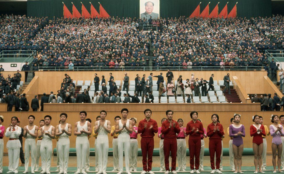 Chinese gymnasts stand in formation after having performed for visiting US President Richard Nixon.