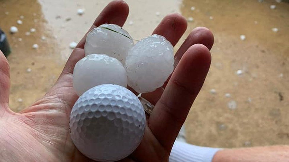 Golf ball next to hail