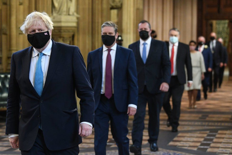 Prime Minister Boris Johnson and Labour leader Sir Keir Starmer walk through the Central Lobby on the way to the House of Lords to listen to the Queen's Speech