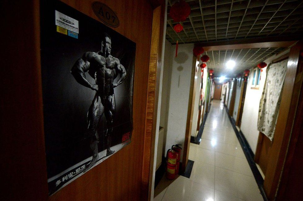 This picture taken on 14 January 2014 shows a poster on the door of a room at the entrance to a basement in Beijing