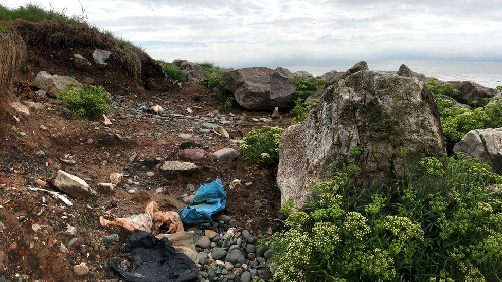 Legacy landfill site on the coast