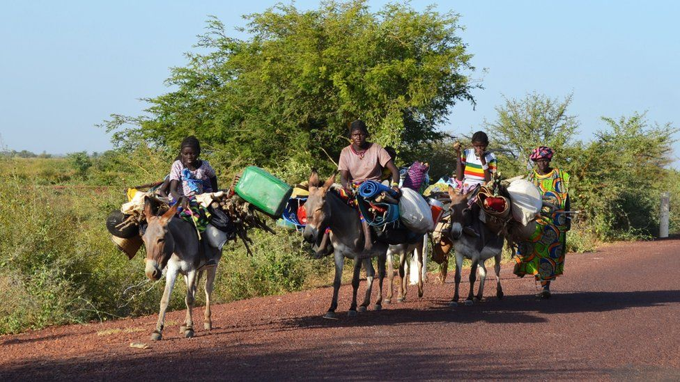 Villagers riding on donkey back