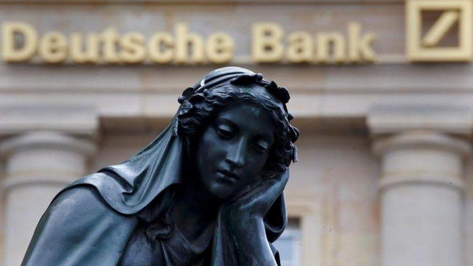 Statue next to Deutsche Bank