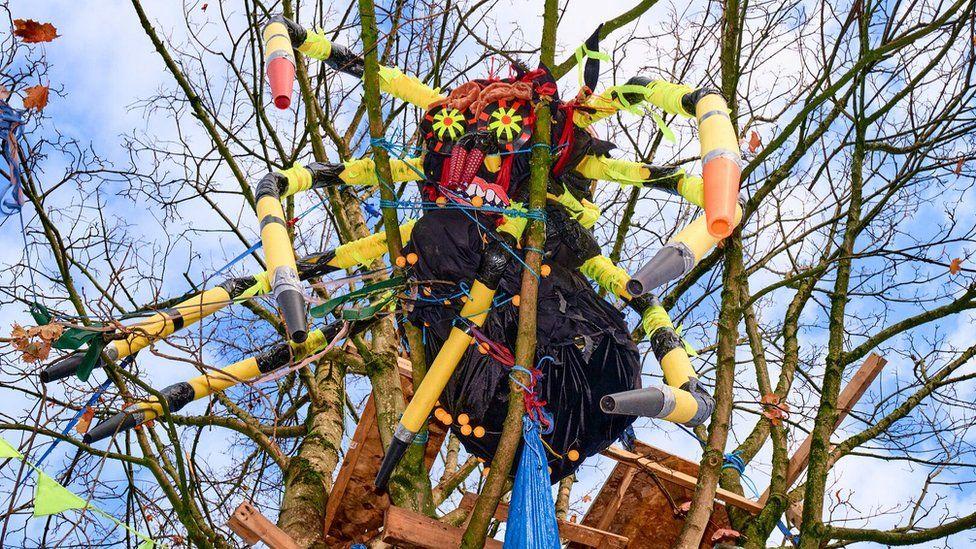Activist Rowland Dye's spider sitting in the tree