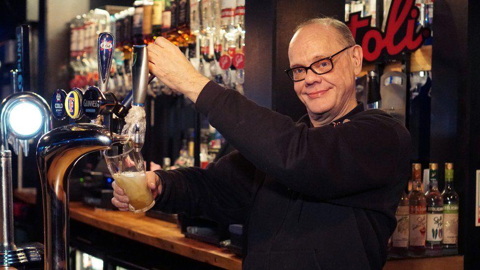 Mark Oakley in his bar