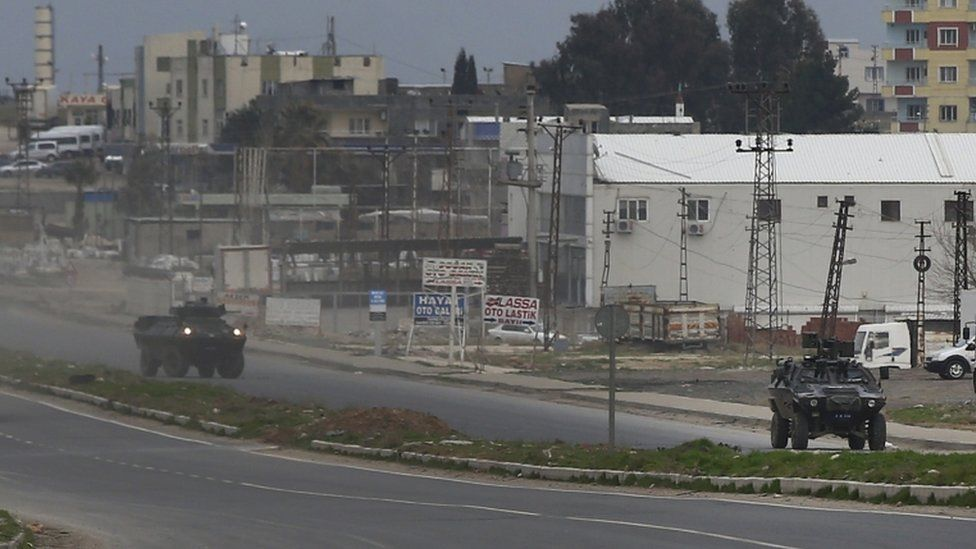 Turkish armoured vehicles patrol at the south-eastern town of Nusaybin, 14 Feb