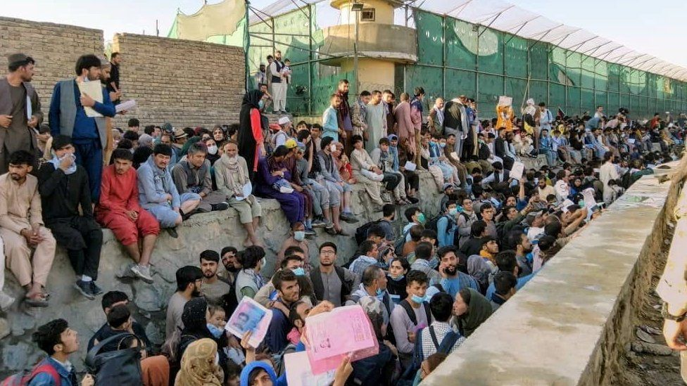 Crowds of people wait outside Kabul airport