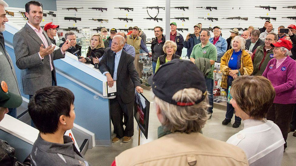 Mr Trump campaigns for his father at a gun store in Maine in 2016