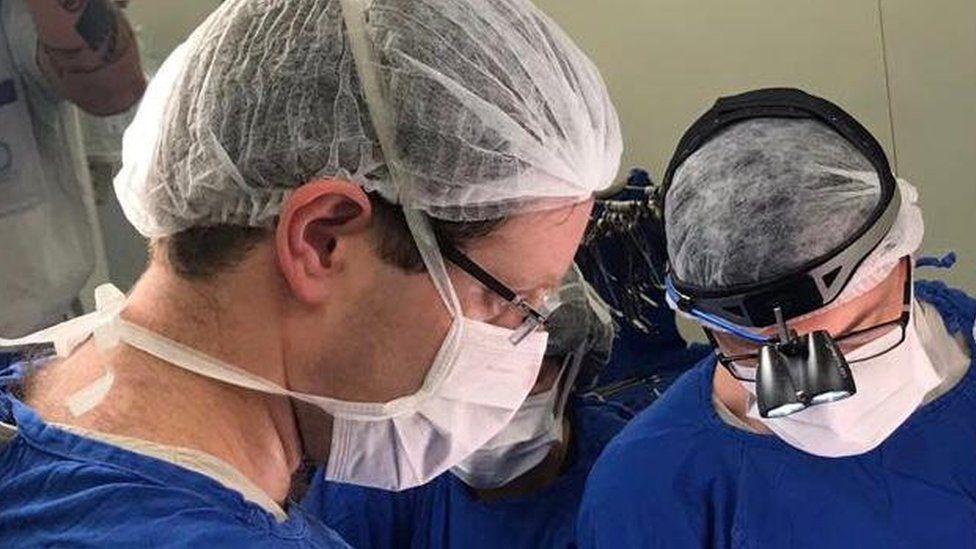 Doctors perform the womb transplant