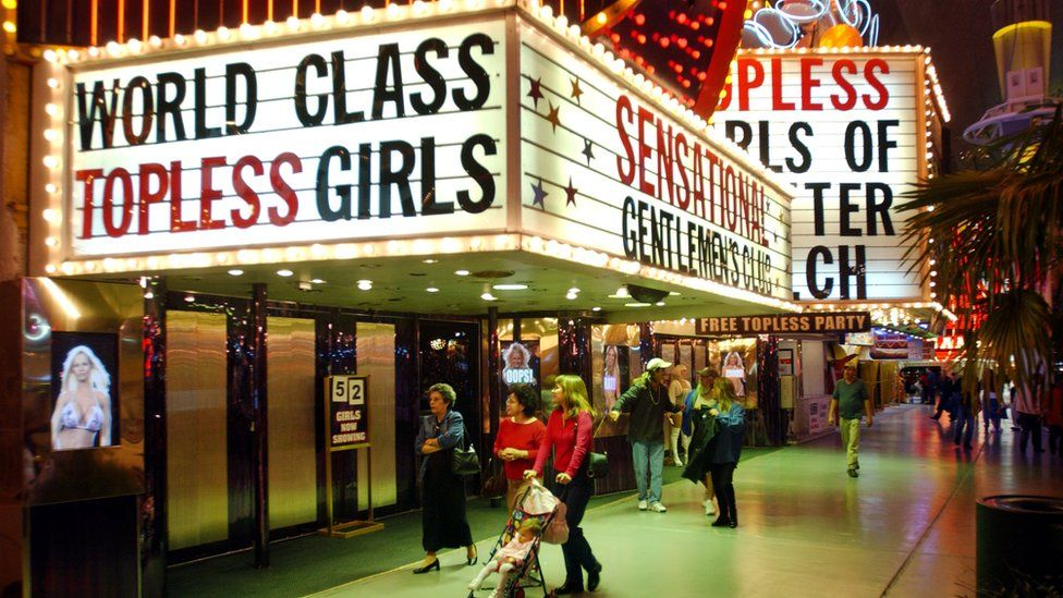Image from 90s of a sign for 'World Class Topless Girls' in Las Vegas' Freemont Street