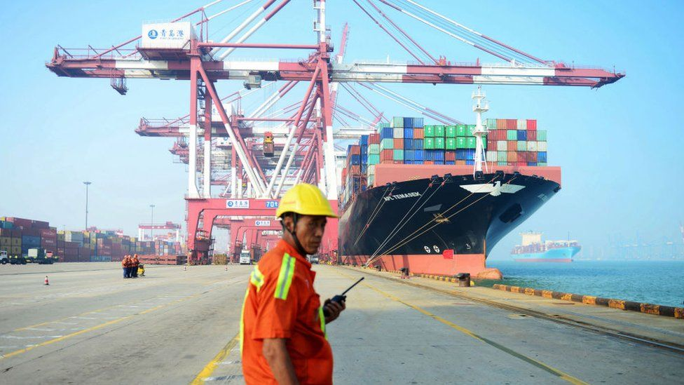 Dock worker in front of ship