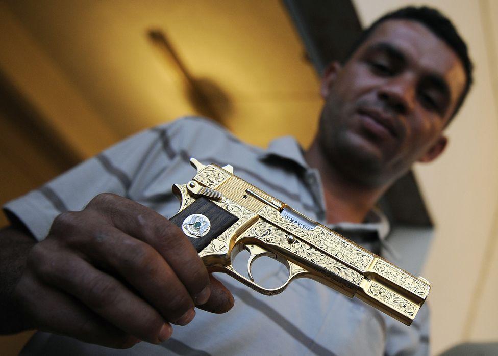 Nabil Ali Dagouich with gun