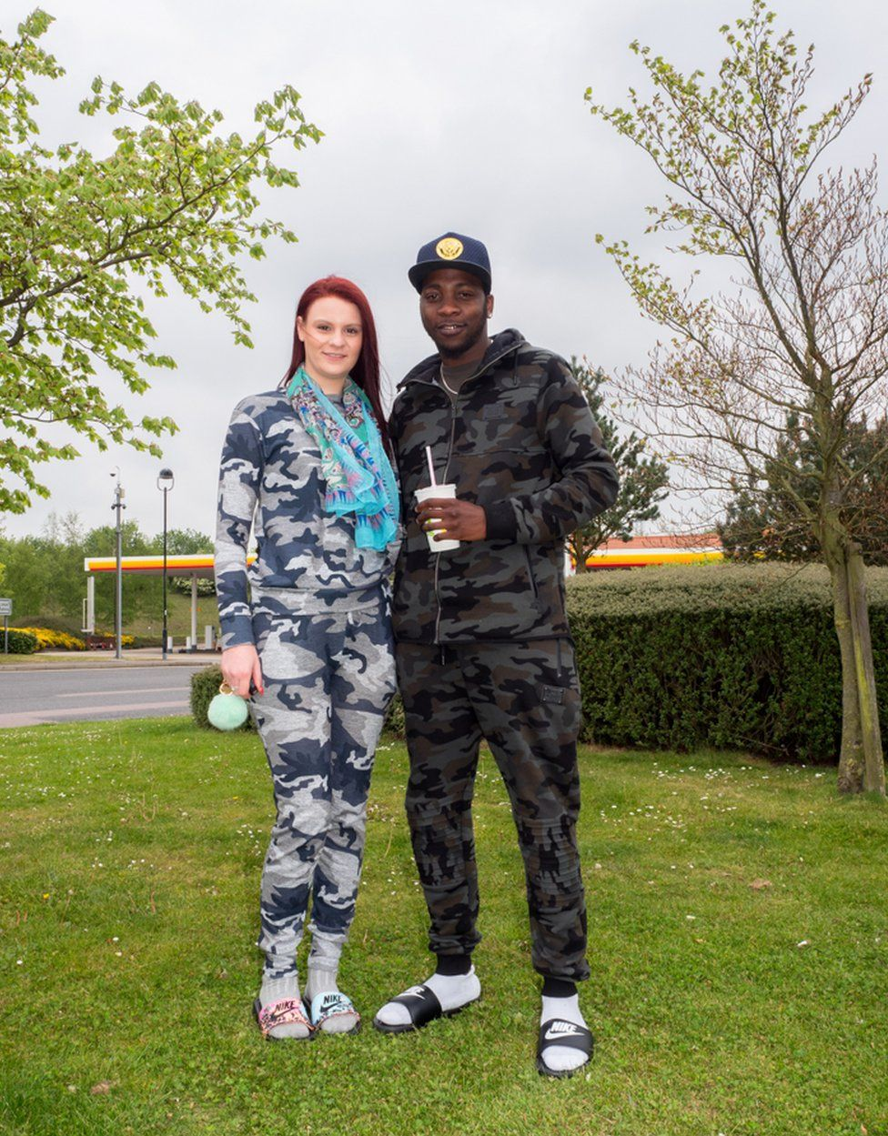 Challis Cooper (20) and Arnold (22) take a break at Baldock Extra Motorway Services, on their way to visit family in Great Yarmouth. Radwell, Baldock, Bedfordshire.