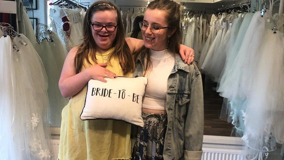 Heidi and her sister Suzie in a wedding dress shop