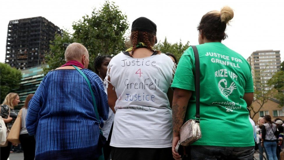 People attend a silent march to pay respect to those killed in the Grenfell Tower disaster