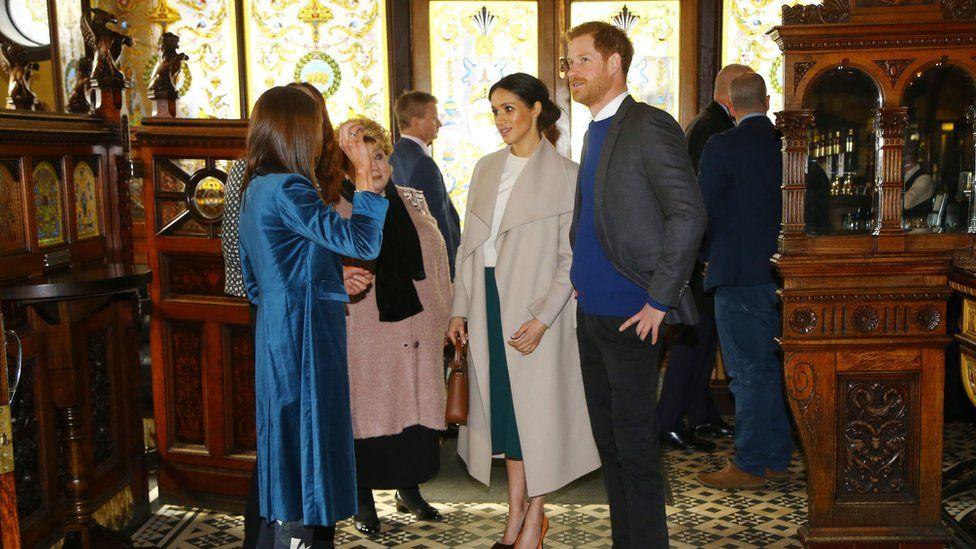 Prince Harry and Ms Markle arrive at the Crown Bar in Belfast