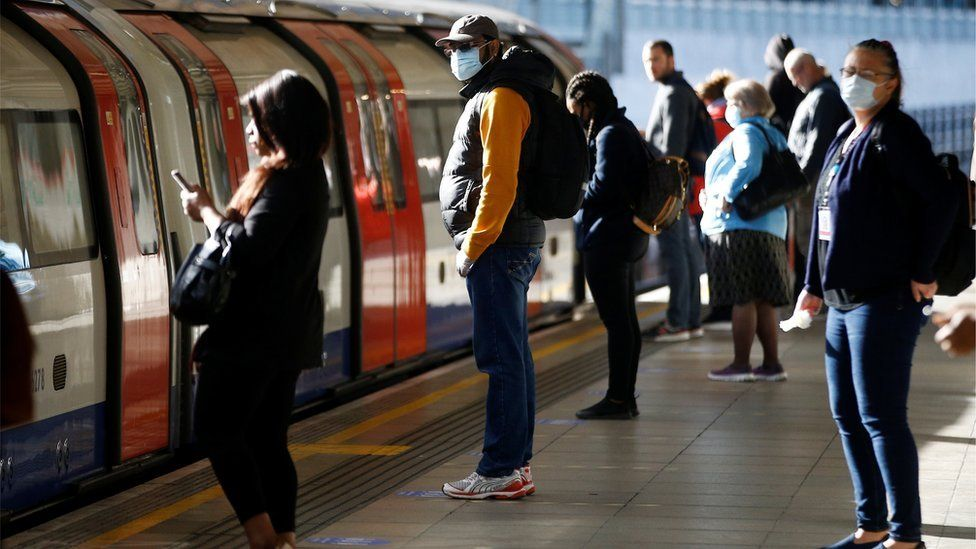 Commuters at Canning Town underground station in east London