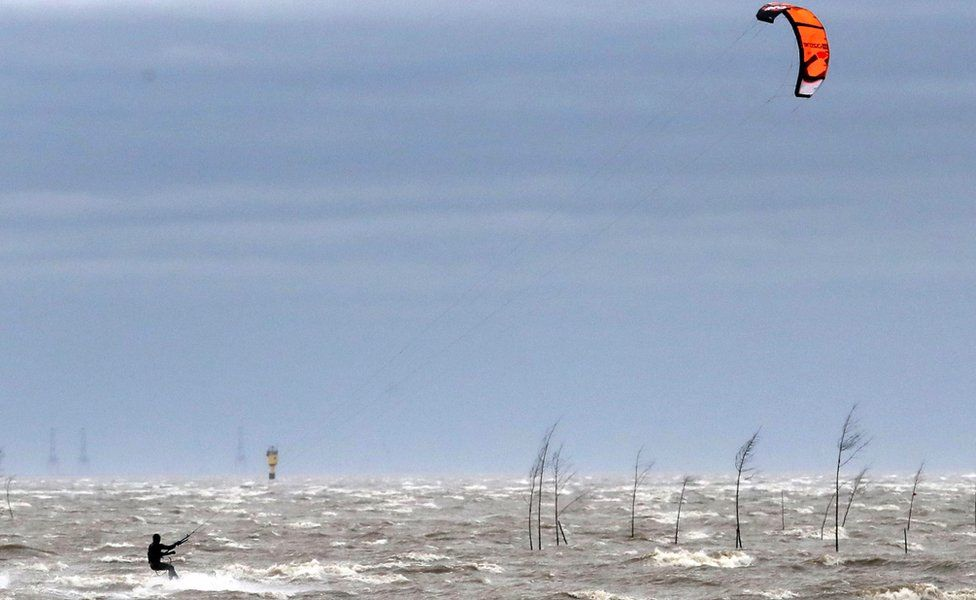 A kite surfer on the Weser river in Bremerhaven, northern Germany, 9 February 2020