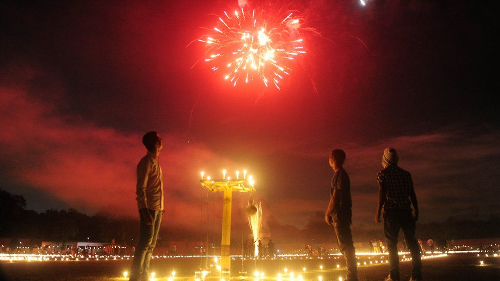 Indian athletes watch fireworks at the Madan Mohan Malviya stadium on the eve of the Hindu festival of Diwali in Allahabad on October 29, 2016