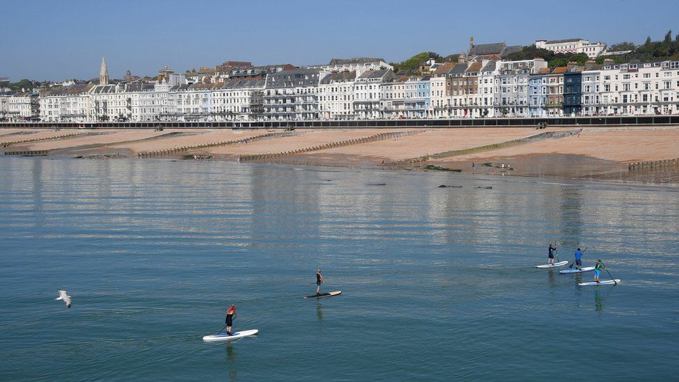 Paddle boarders in the sea at Hastings