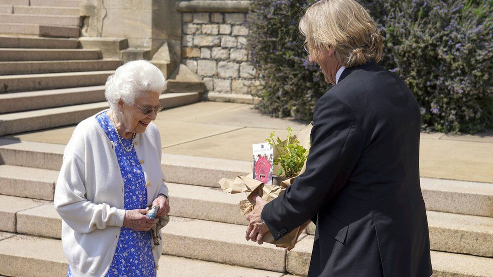 Queen Elizabeth II receives a Duke of Edinburgh rose, given to her by Keith Weed, President of the Royal Horticultural Society,, at Windsor Castle, Berkshire.