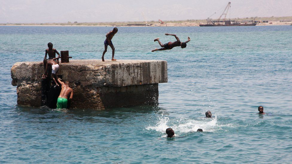 In Tadjoura during the hot morning heat, children play in the waters around one of the berthing points for the ferry that plies the route to Djibouti city.