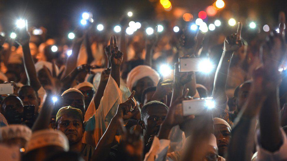 Demonstrators in Sudan with mobile phones at night - May 2019