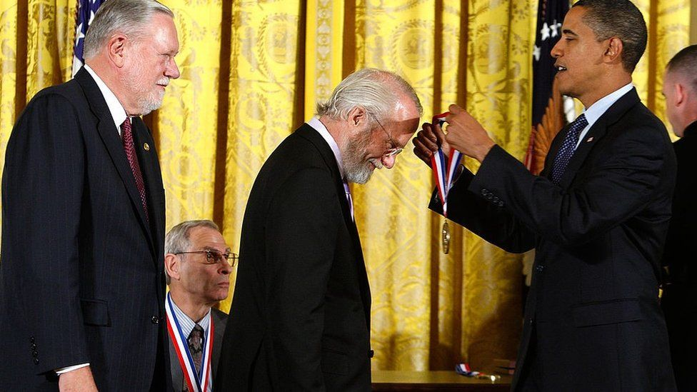 Barack Obama presents a National Medal of Technology and Innovation to John E. Warnock, co-founder of Adobe Systems Inc., as co-founder Charles M. Geschke