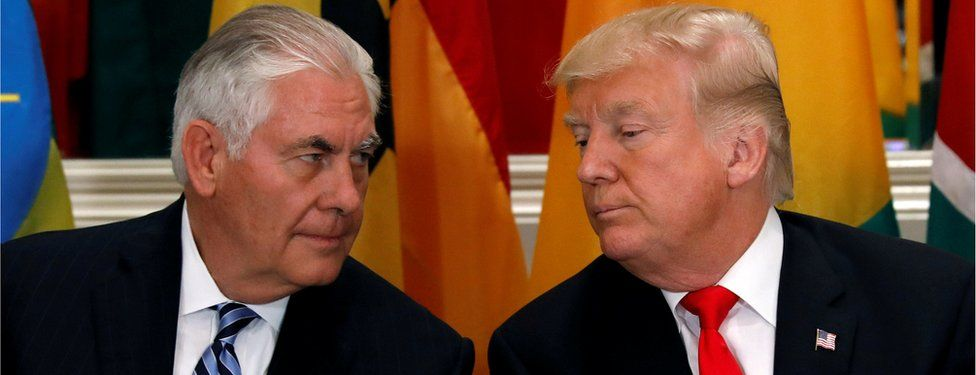 Rex Tillerson, left, leans eye-to-eye with Donald Trump, right, in a file photo taken 20 September