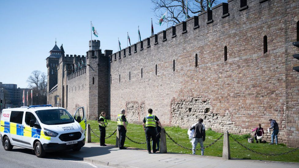 Police move on a group of three people from Cardiff Castle
