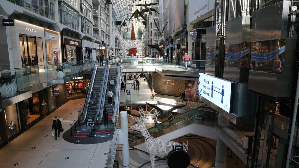 Shoppers walk through the Eaton Centre as Ontarios residents and businesses brace for an announcement from the Province on possible stricter measures to slow the spread of COVID-19 in Toronto