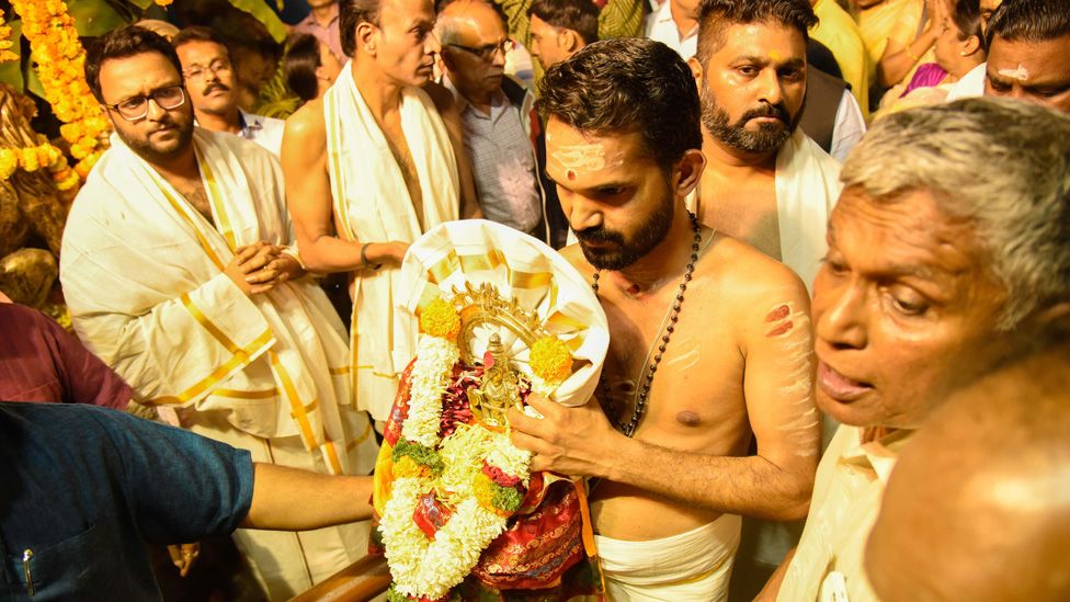 People of Malayali community wait for the temple doors to open at Makara Vilakku Mahotsavam at Ayyappa temple in Rasta Peth, on January 14, 2018 in Pune,