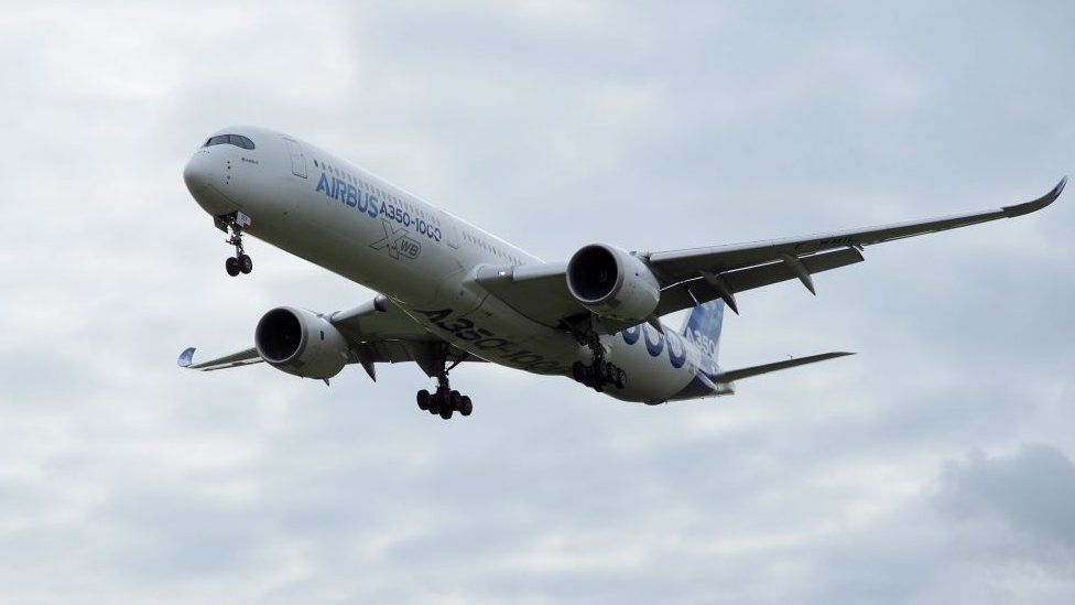 An Airbus A350-1000 conducts a test flight over Chateauroux airport, central France.