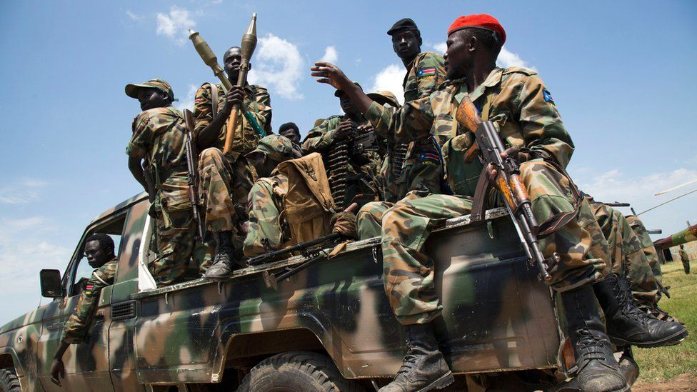 Soldiers of the Sudan People Liberation Army (SPLA) sit in a pick-up truck at the military base in Malakal, northern South Sudan, on October 16, 2016.