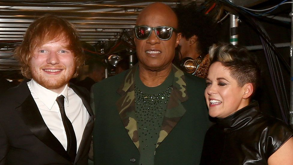 Amy Wadge with Ed Sheeran and Stevie Wonder at the Grammy awards
