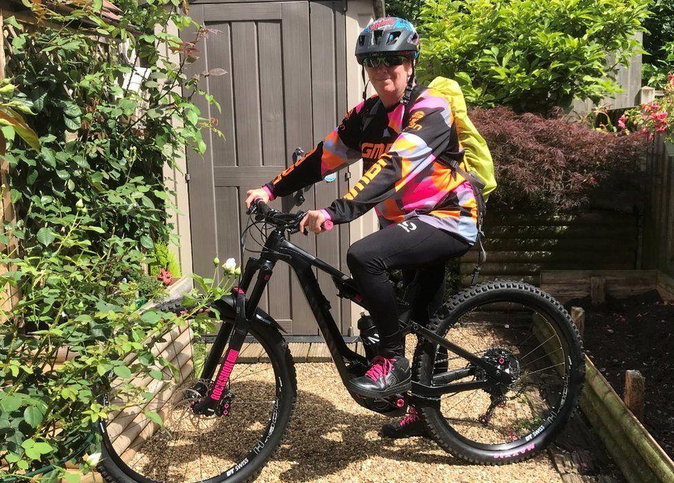 Dom Thompson on her e-bike