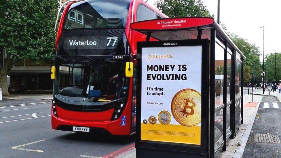 A Binance bus shelter ad near St Thomas' Hospital in London