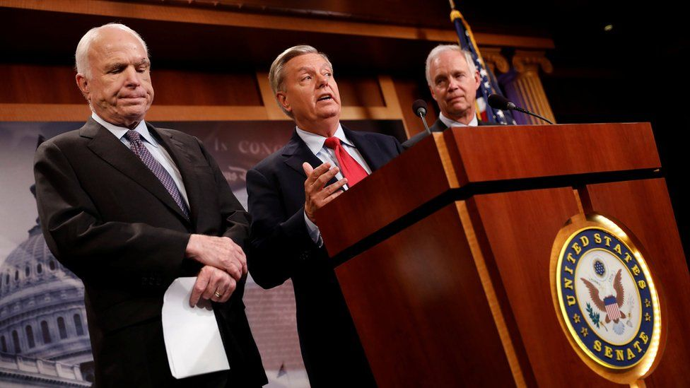 """Senator Lindsey Graham, accompanied by Senator John McCain and Senator Ron Johnson, speaks during a press conference about their resistance to the so-called """"Skinny Repeal"""" of the Affordable Care Act on Capitol Hill in Washington"""
