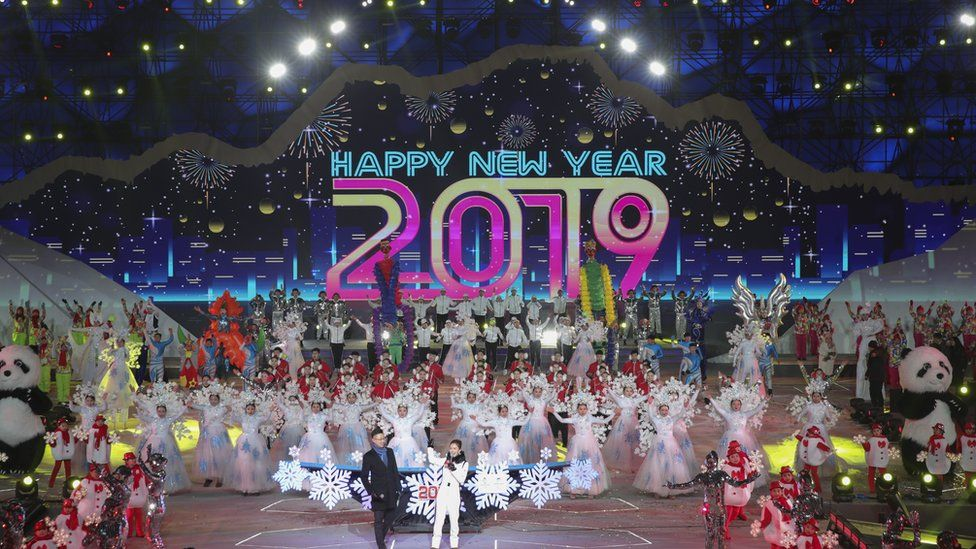 Chinese people celebrate during a New Year's Eve ceremony in Beijing, China, 31 December 2018