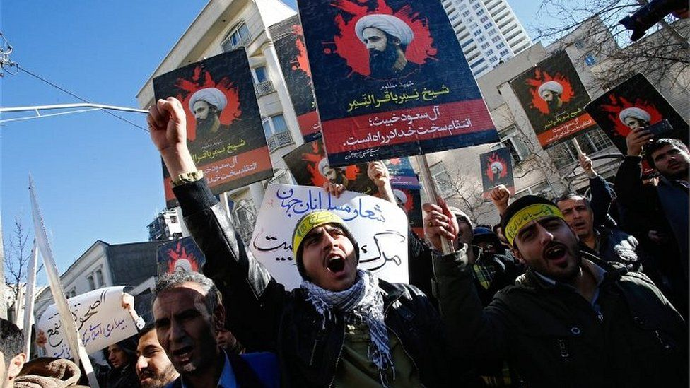 Iranian protesters hold placards of Nimr al-Nimr at a demonstration near Saudi embassy in Tehran (03/01/16)