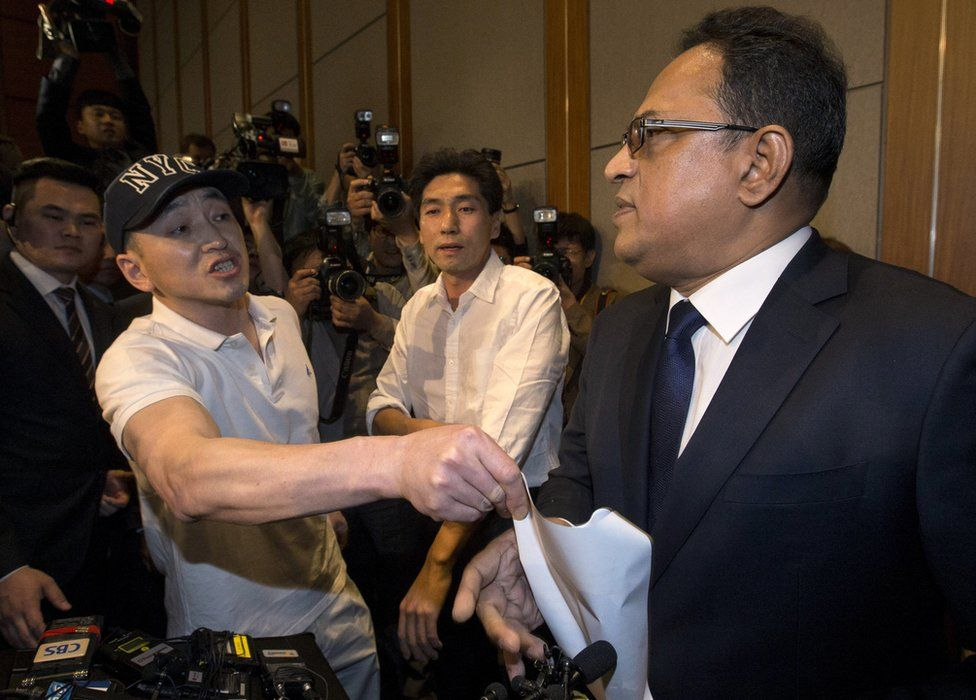 A relative of a victim complains to Ataur Safdar, head of British firm Reckitt Benckiser Korea, right, during a press conference in Seoul, South Korea, Monday, 2 May 2016
