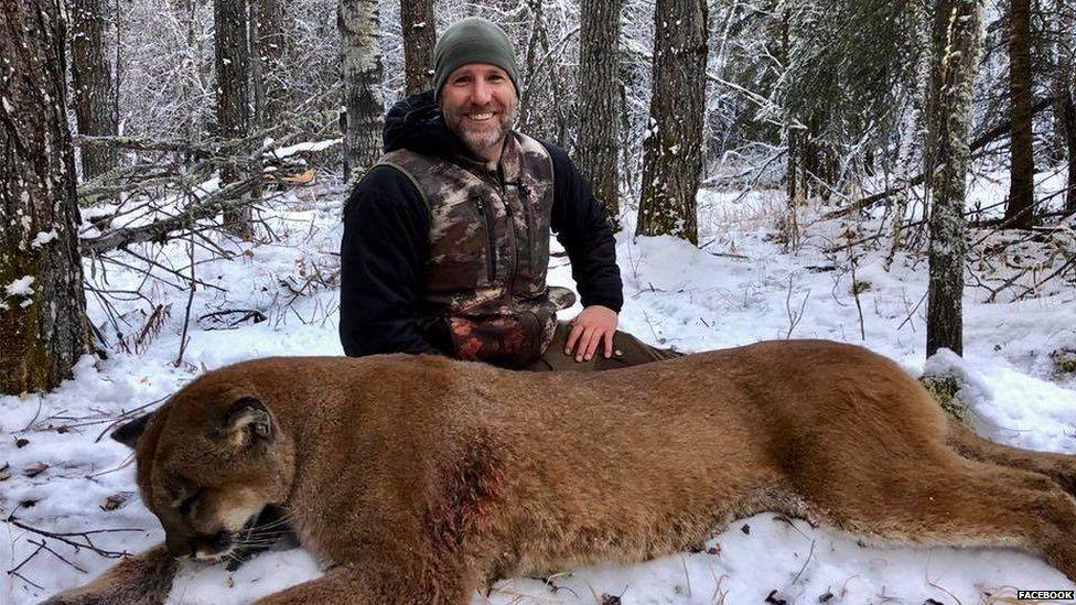 Steve Ecklund with cougar