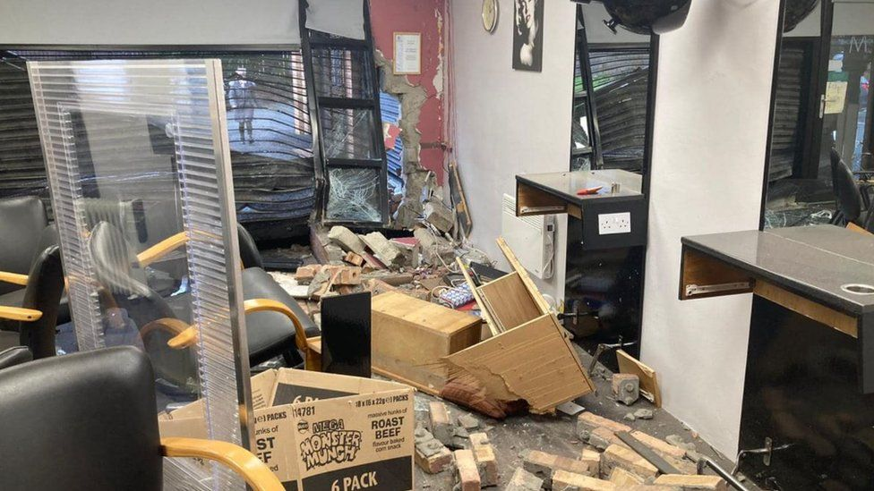 The damage caused by the crash inside the salon