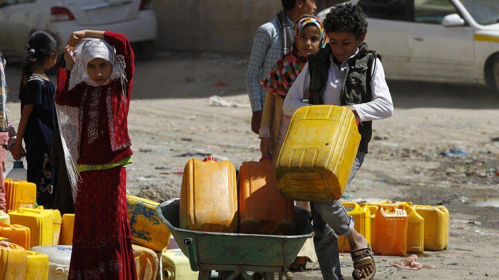 Children collect safe drinking water in Sanaa, Yemen
