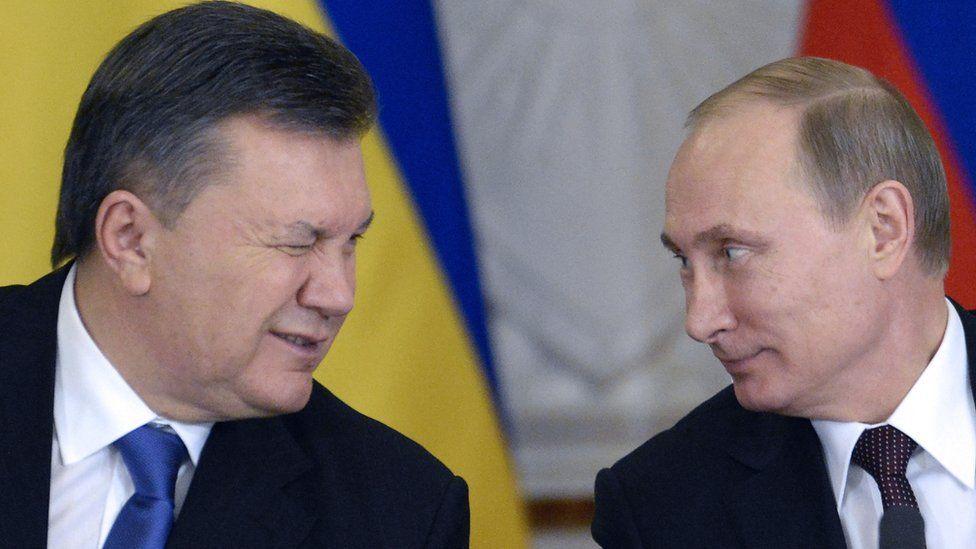 Ukraine's ex-President Viktor Yanukovych (left) with Vladimir Putin