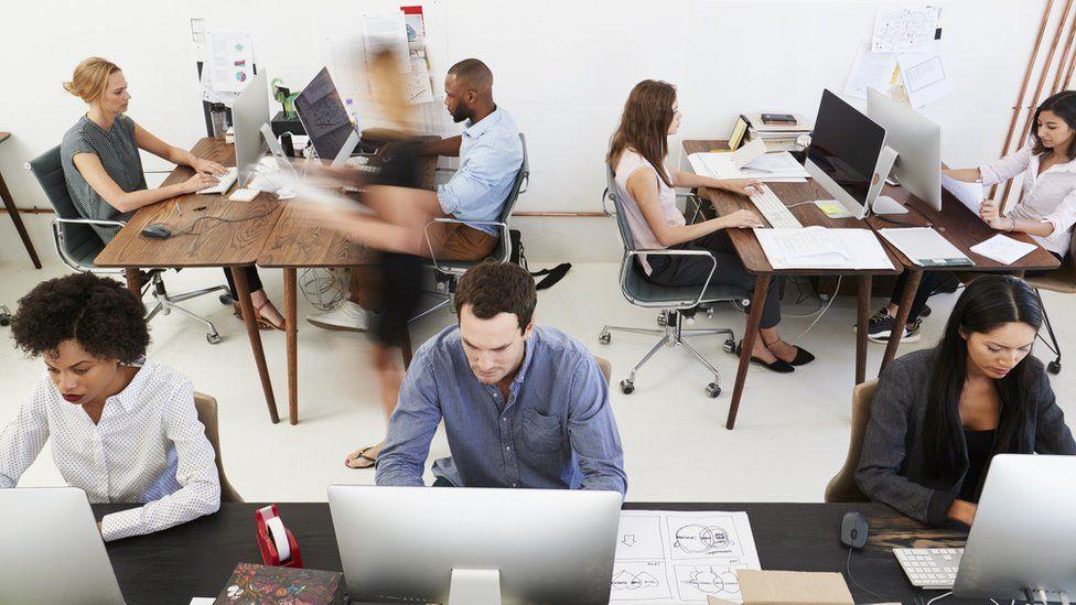 People working in an open plan office